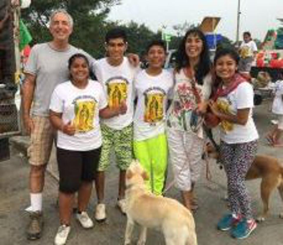 Jet Metier and Chuck Bolotin with celebrants of Virgin of Guadalupe in Mexico