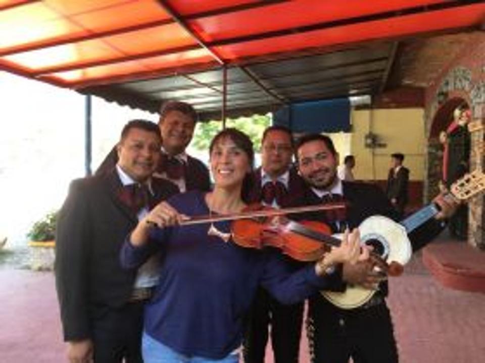 Jet Metier plays the violin at quincinera in Mexico
