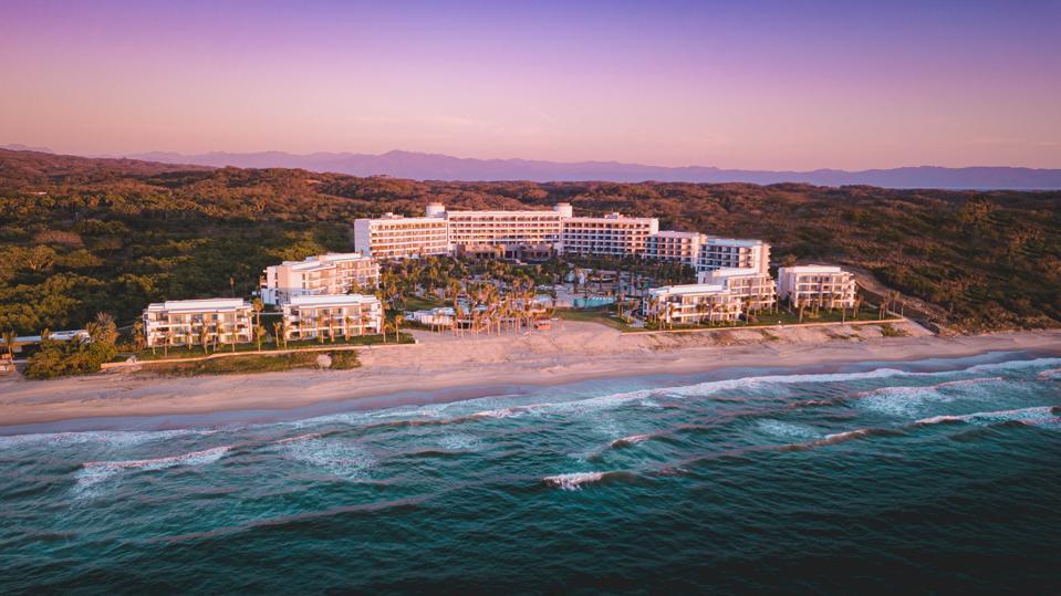 A sprawling hotel near the ocean.