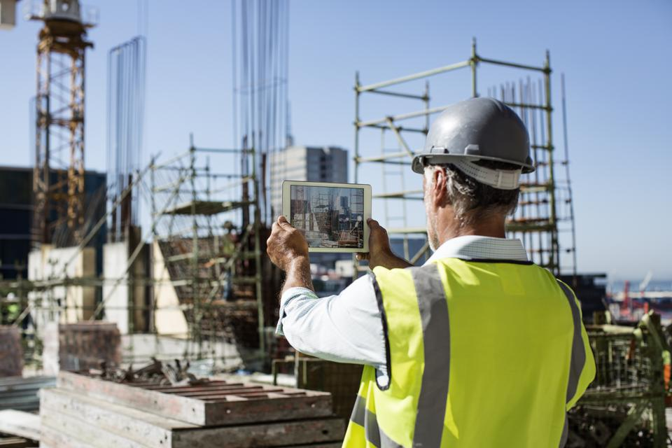 Male architect photographing construction site