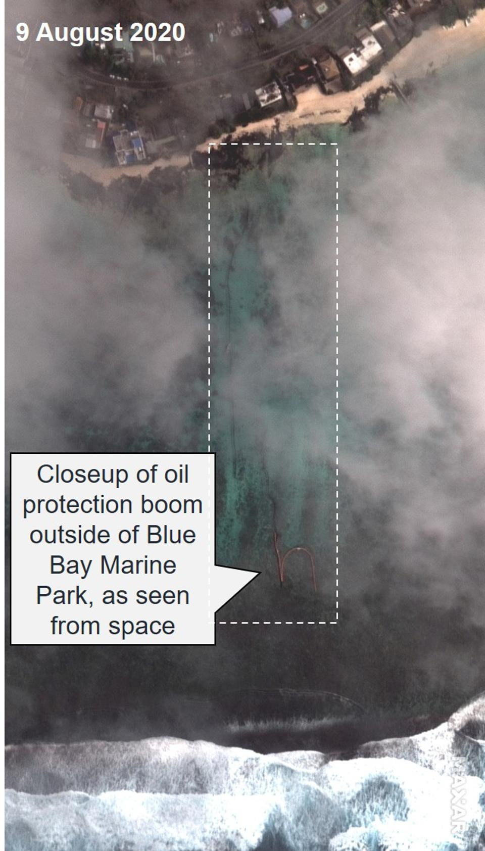 9 August 2020: Closeup of Oil Protection Boom around Blue Bay Marine Park, as seen from space