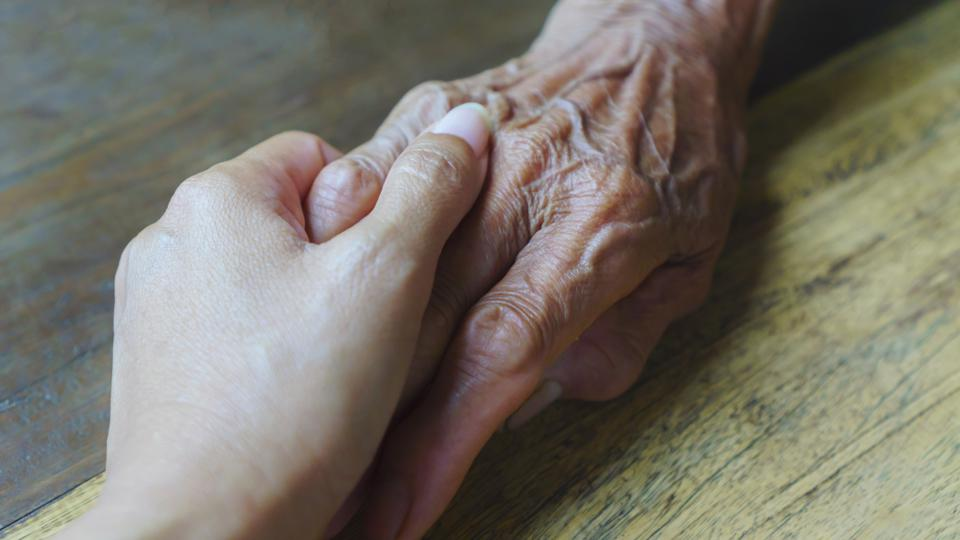 Help concept, hands of the elderly and young