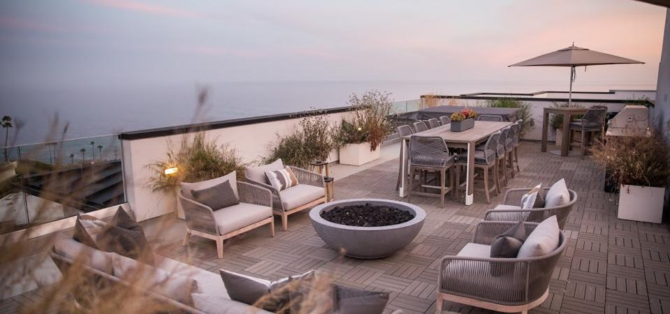 Outdoor living area at One Coast home.