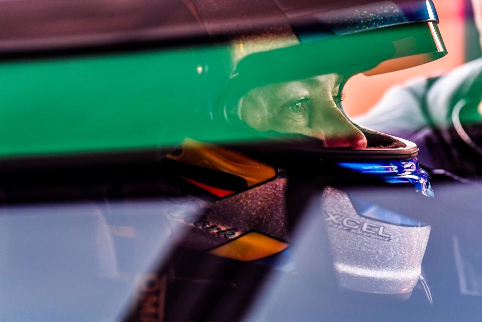 Lisa Clark sitting inside her race car