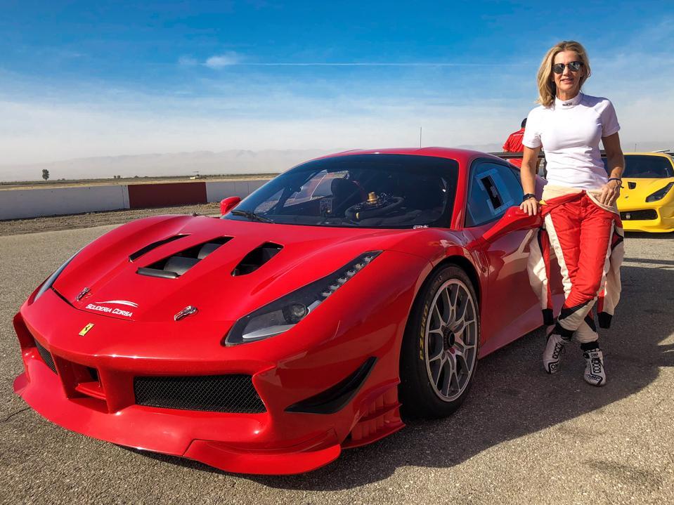 Lisa park next to a Ferrari 488 Challenge race car
