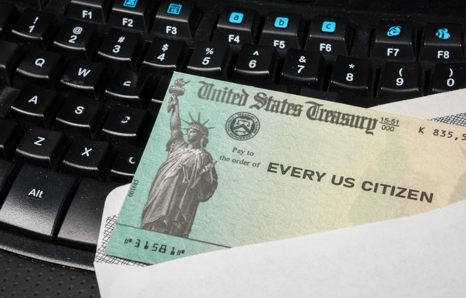 Illustration of the federal stimulus payment check from the IRS on keyboard
