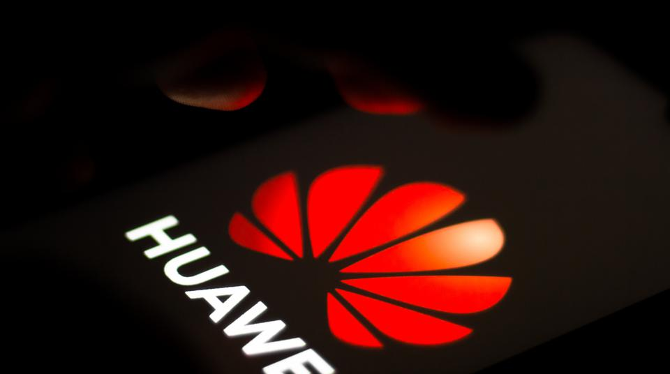In this photo illustration the Huawei Technologies logo seen...