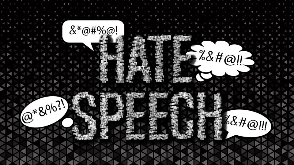 Hate speech with chat bubbles on dark background.