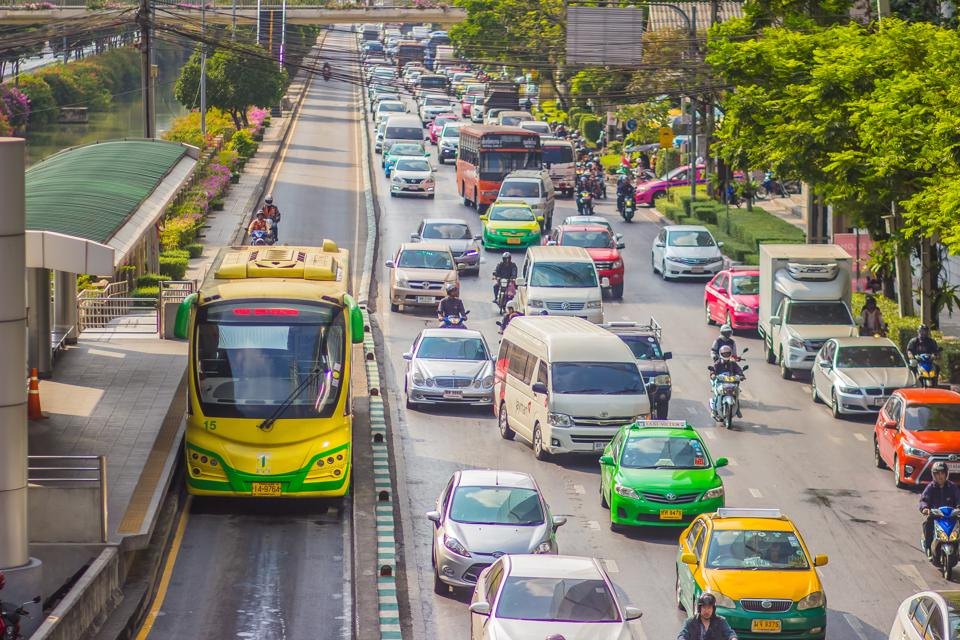 Bangkok, Thailand - February 21, 2017: View of The Bangkok BRT, bus rapid transit system in Bangkok,Thailand. The buses run on dedicated bus lanes in the center of the road to avoid typical curb-side delays.