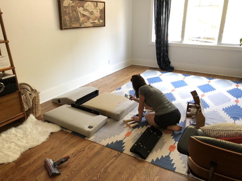 Assembling a couch.