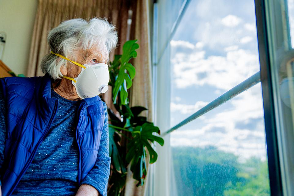 Older woman wearing a mask to protect against Covid-19