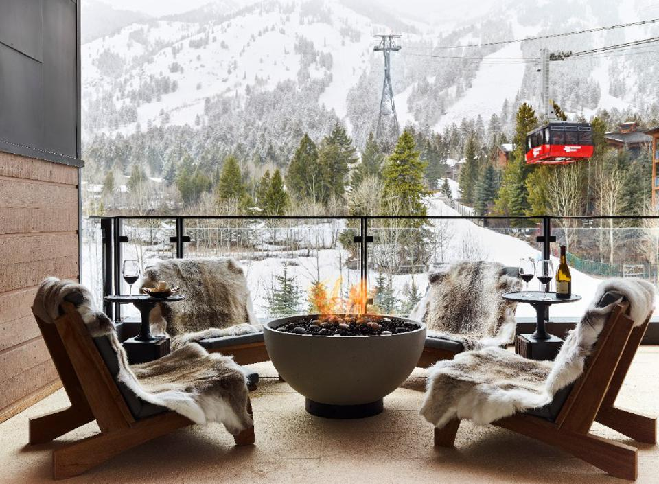 Outdoor patio with firepit overlooking ski mountain.