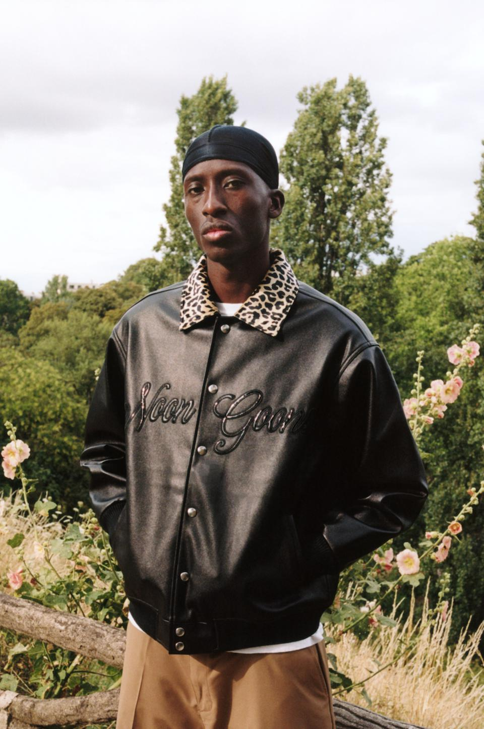 The Noon Goons FW20 Fly By Leather Jacket features faux leather self fabric with a velvet leopard lining
