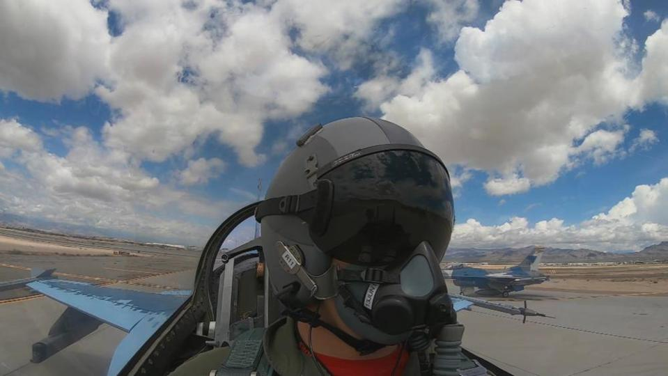 An F-16 aggressor pilot in a 64th Aggressor Squadron F-16 at Nellis Air Force Base, Nevada