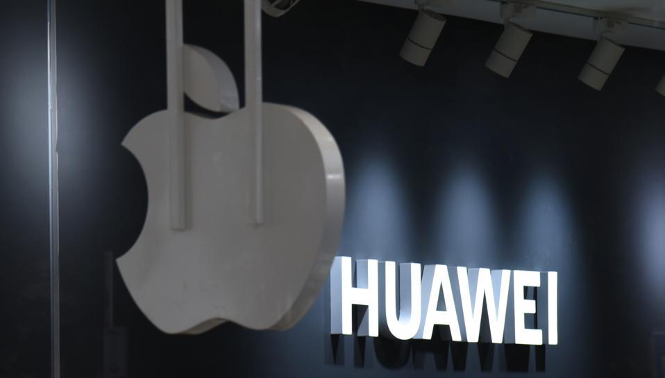 Huawei And Apple Logo In Beijing