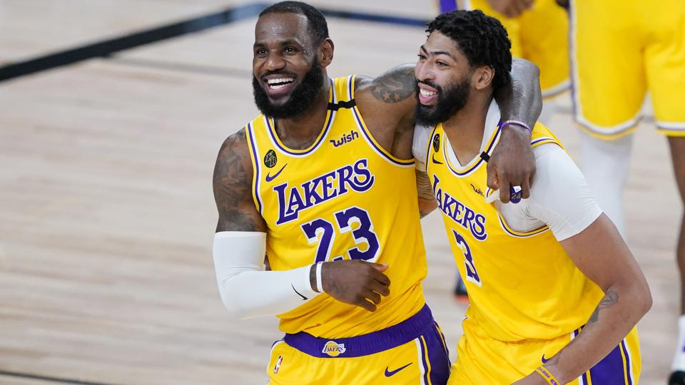 LeBron James and Anthony Davis during the Lakers' 124-121 win over the Nuggets on Aug. 11, 2020.