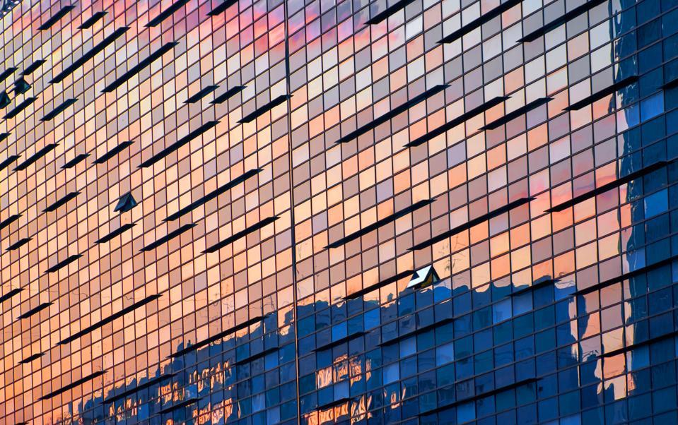 Illuminated Office building at sunset. Bucuresti, Romania.