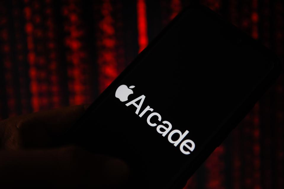 In this photo illustration an Apple Arcade logo seen...