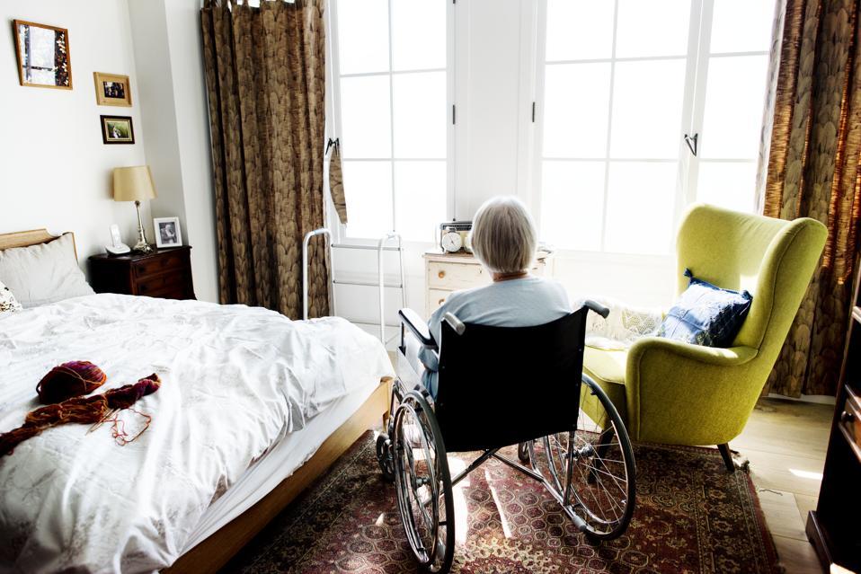Senior woman sitting on the wheelchair alone