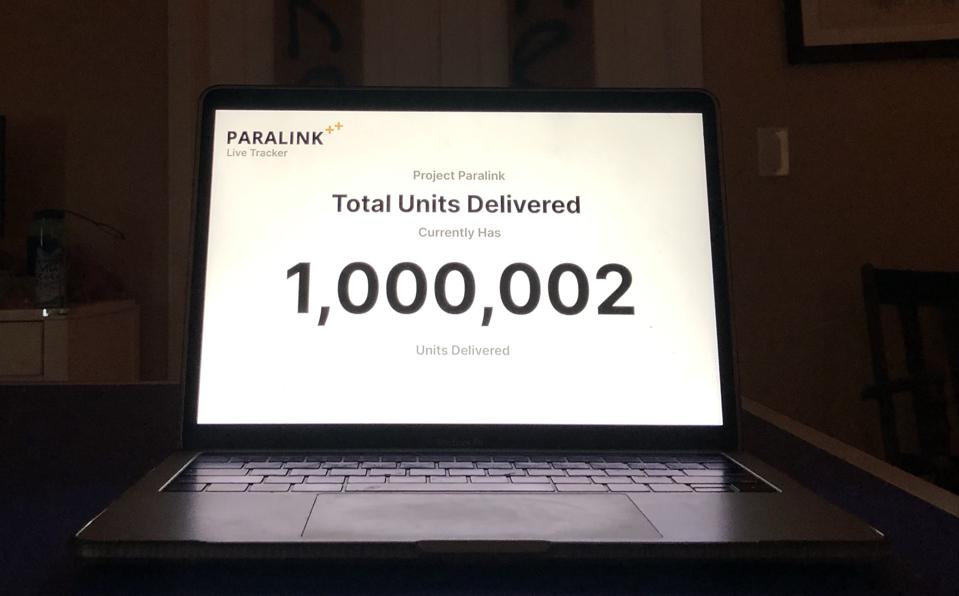 Computer screen shows 1 million deliveries.