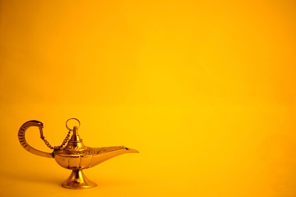 A genie's lamp on yellow background. The world could use 3 wishes these days, ammirite?