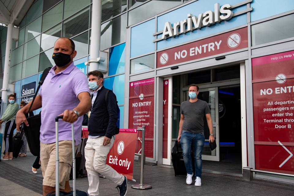 UK travelers return ahead of quarantine on arrival measures in Britain