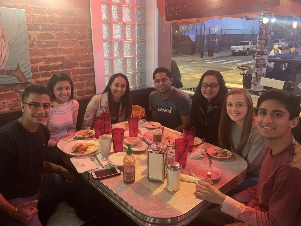 Rohan Arora (right) and several of his college friends enjoying a meal in the heart of campus before the COVID-19 pandemic.