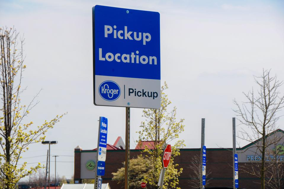 A ″pickup″ sign is displayed at a Kroger grocery store as the coronavirus pandemic prompts some consumers to avoid in-person shopping,  on April 28, 2020 in Canton Township, Michigan.