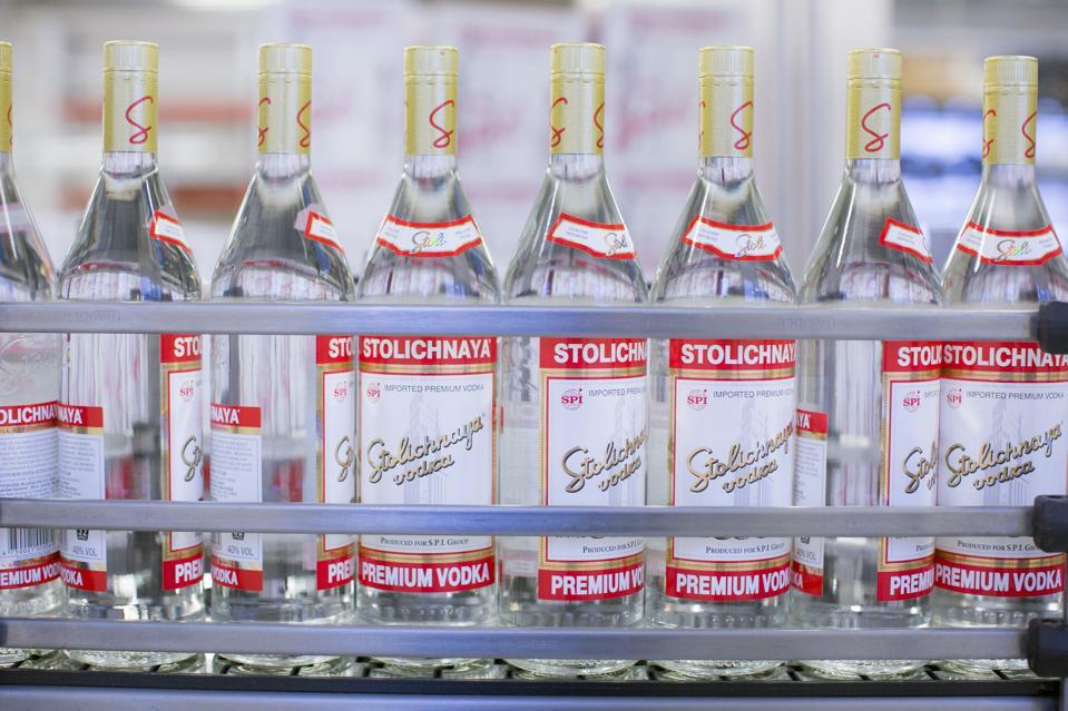Bottles of Stolichnaya vodka after bottling and labeling on the production line in Riga, Latvia, 'Photographer: Jason Alden/Bloomberg