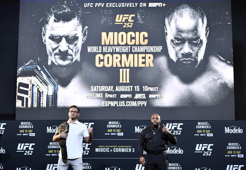 Stipe Miocic and Daniel Cormier headline tonight's UFC 252 pay-per-view card.