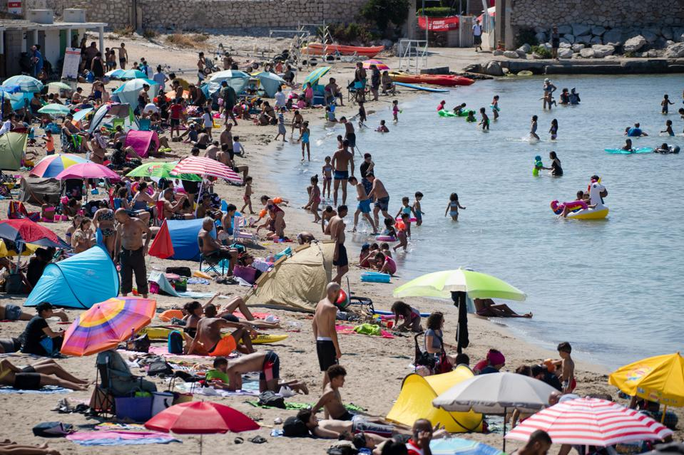 People on the beach in Marseille southern France during Covid