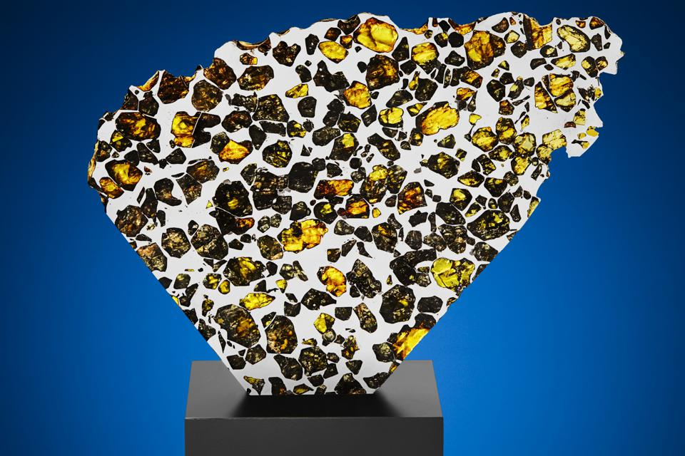Extraterrestrial gems in a large partial slice of sequel pallasite—the most beautiful otherworldly substance?