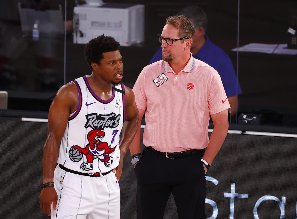 Nick Nurse of the Toronto Raptors talk to Kyle Lowry in game against the Memphis Grizzlies.