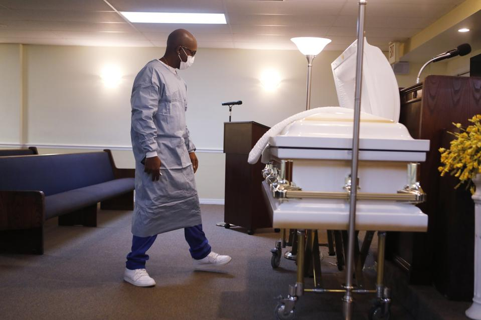 Funeral Home Director In Tampa, Florida Prepares For A Funeral For Man Who Died From Covid-19