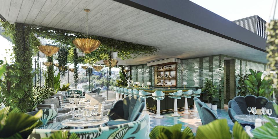 A sunset strip rooftop with greenery, chairs and a bar.