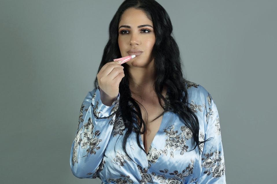 meeta vengapally applying lip gloss