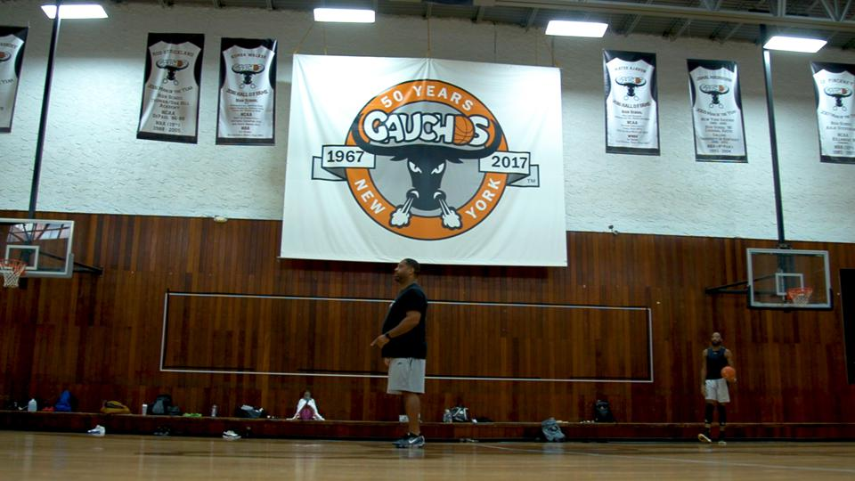 Book Richardson stands in the Gauchos Gym in New York where he's working out players after being released from prison.