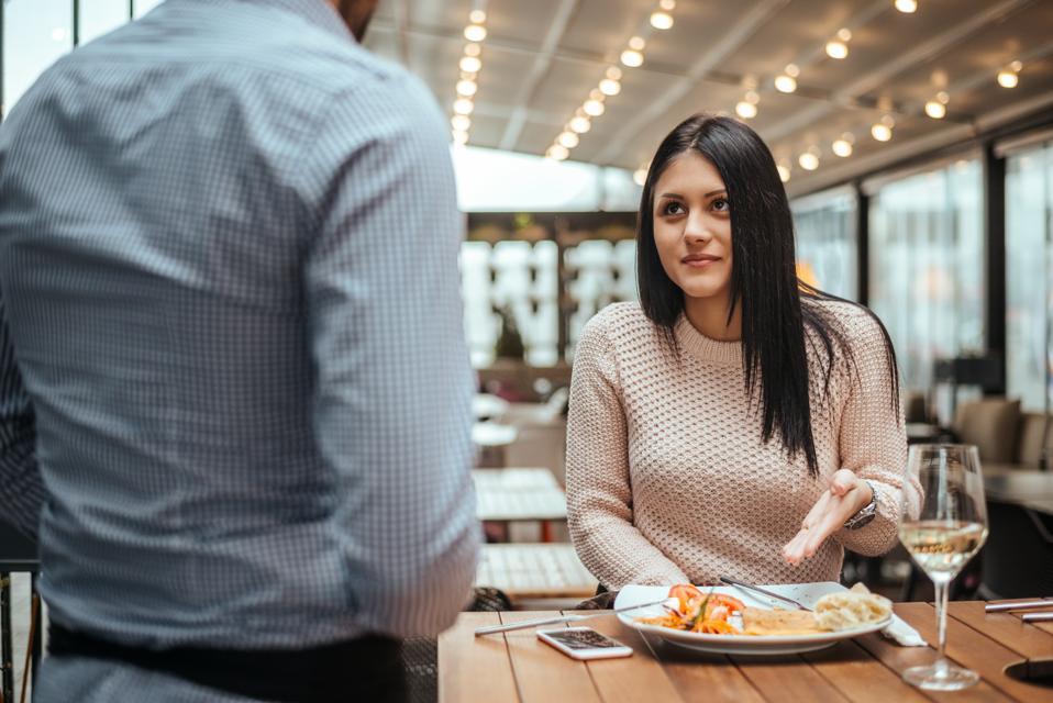 Disagreement between a waiter and a customer in a restaurant.