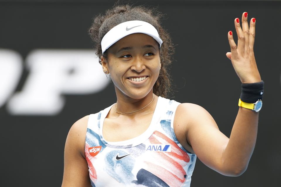 MELBOURNE, AUSTRALIA - JANUARY 22: Naomi Osaka of Japan shows appreciation to the crowd after winning her Women's Singles second round match against Saisai Zheng of China on day three of the 2020 Australian Open at Melbourne Park on January 22, 2020 in Melbourne, Australia.  (Photo by Fred Lee/Getty Images)