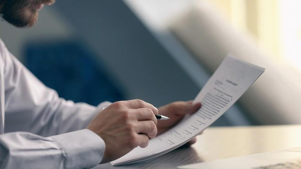 Close up of Businessman reading documents