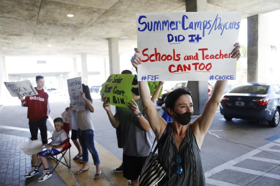 Hillsborough County Florida Teachers Protest Reopening Schools As School Board Meets To Vote On Decision