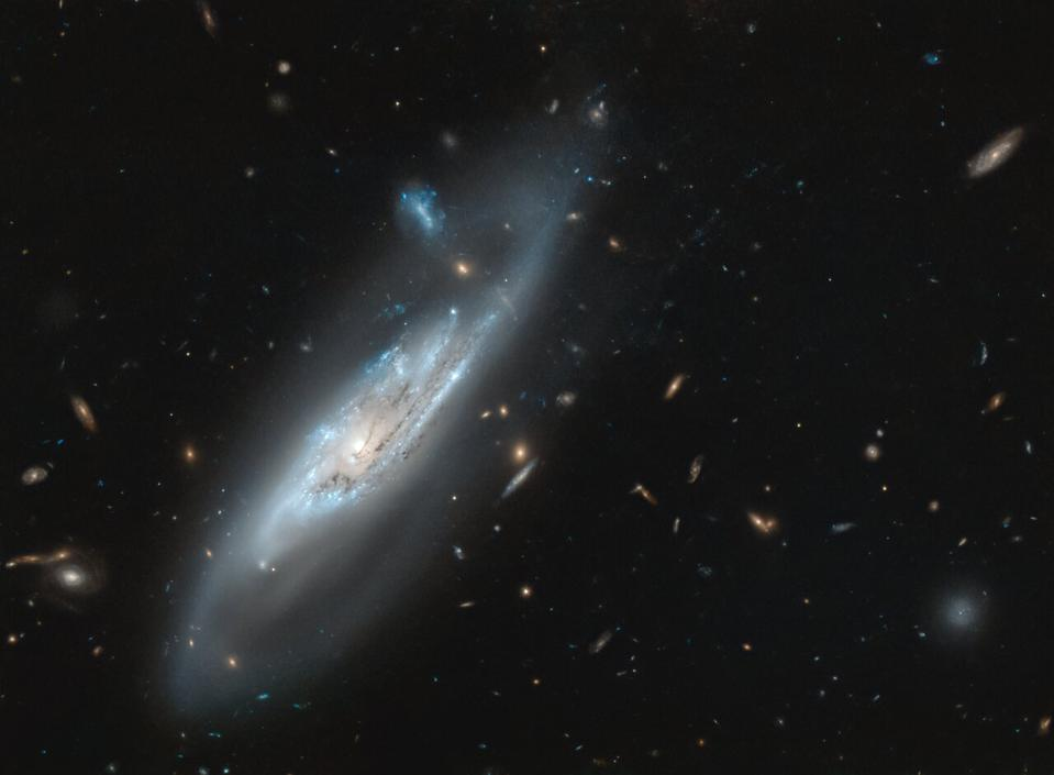 The stunning silvery-blue spiral arms of the galaxy NGC 4848.