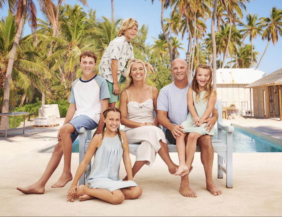 Bryan & Sarah Baeumler and their family at Caerula Mar Club