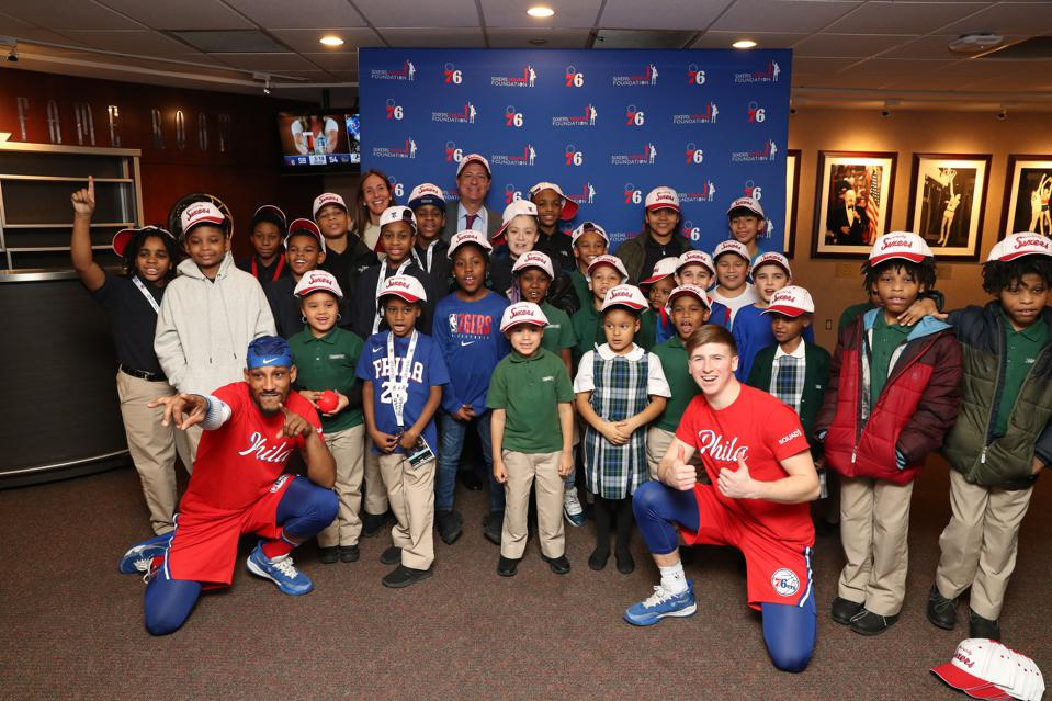 HBSE Cofounder David Blitzer with Philadelphia-based youth prior to a Philadelphia 76ers game
