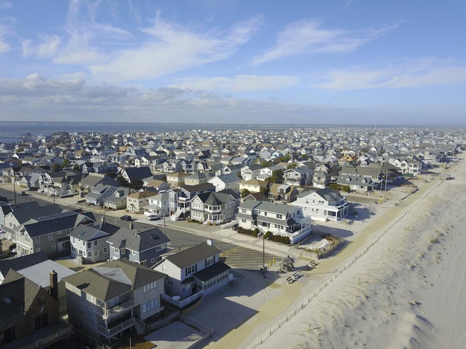 Aerial view of houses next to beach, looking up the Coast of NJ