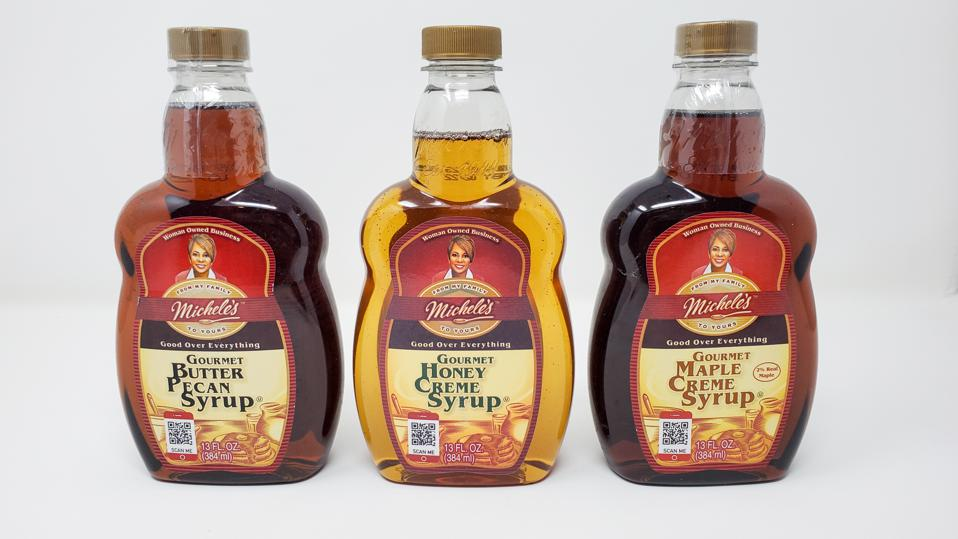 michele foods syrups standing in line on gray white background