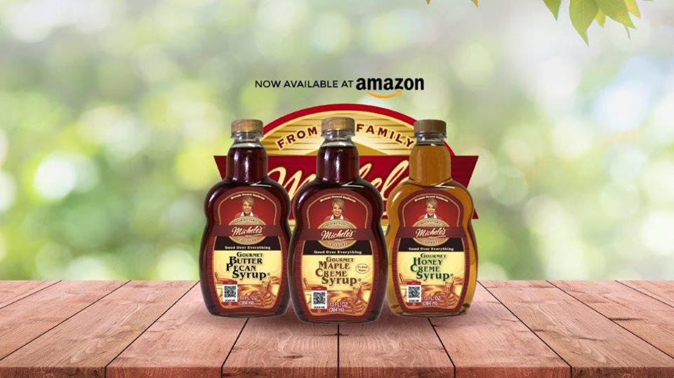 michele food syrups on wooden table with tree backdrop and amazon logo