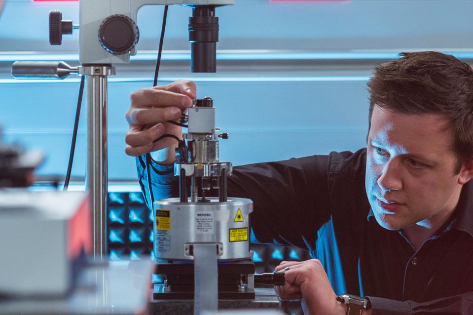 Scientist adjusting equipment at a nanoscale materials lab