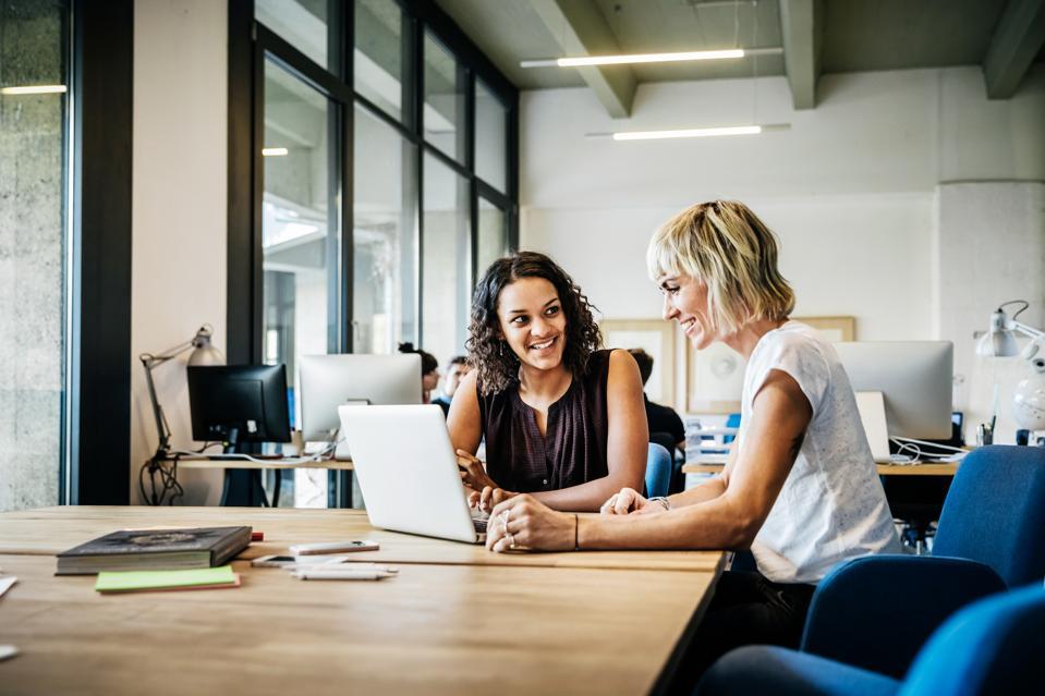 Casual start up businesswomen talking