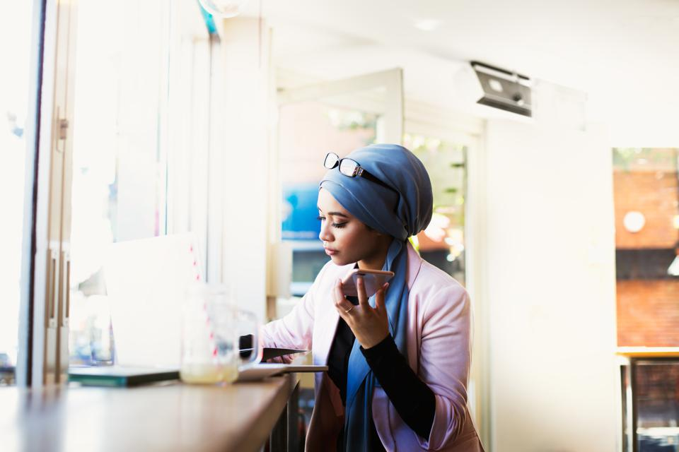 Young Muslim Woman Working in Cafe